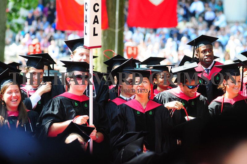 Harvard Medical Students stand as University President Drew Faust confers their degrees.