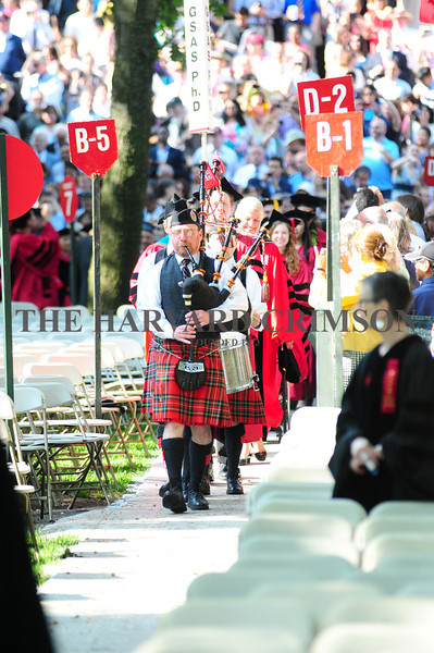 Bagpipes and drums lead the Graduate School of Arts and Sciences Ph. D. students to their seats in Tercentenary Theatre on Thursday.