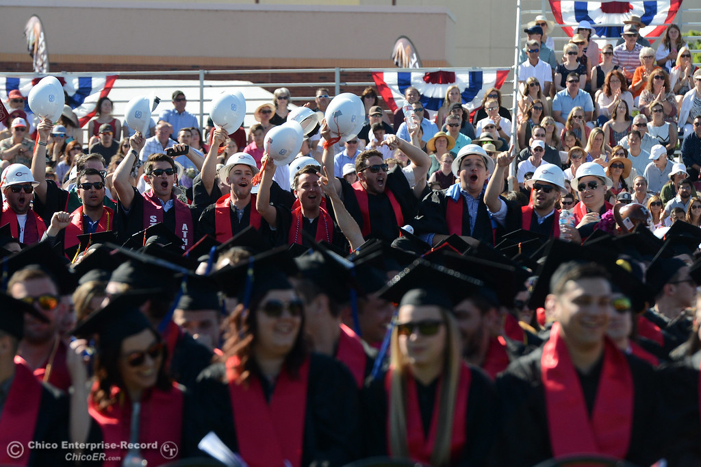 . Construction management graduates stand up, cheer and wave their hard hats during the Chico State commencement ceremony Sunday, May 21, 2017, at University Stadium in Chico, California.  (Dan Reidel -- Enterprise-Record)