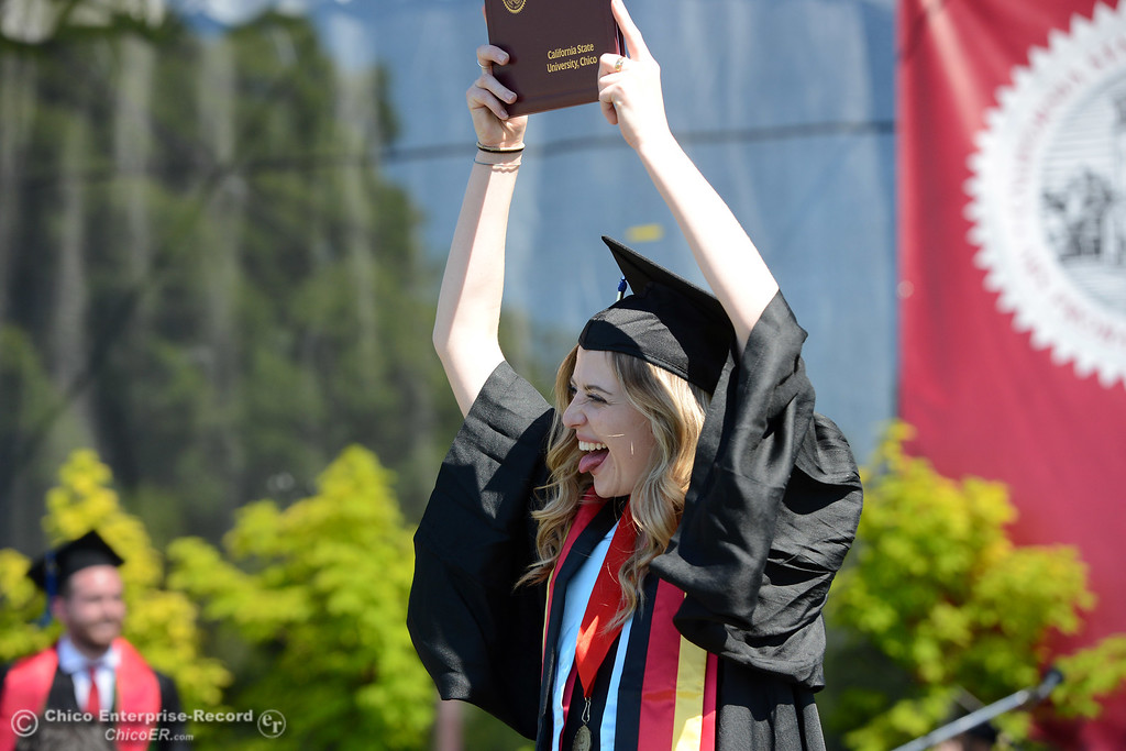 . Olivia Gulsvig celebrates earning her diploma during the Chico State commencement ceremony Sunday, May 21, 2017, at University Stadium in Chico, California.  (Dan Reidel -- Enterprise-Record)