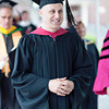 Associate Vice President for Marketing, Jeremy Solomon, processes into the Commencement tent.