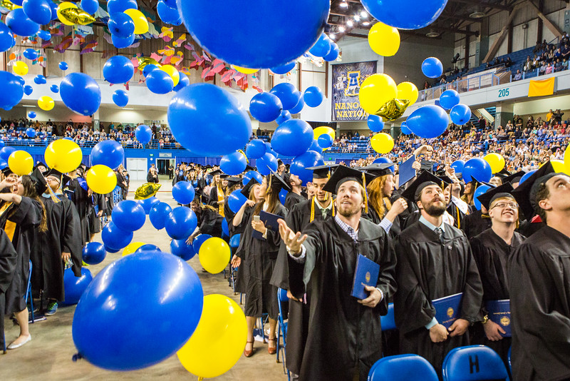 """Graduates react to the ceremonial balloon drop during the Commencement 2016 ceremony.  <div class=""""ss-paypal-button"""">Filename: GRA-16-4896-991.jpg</div><div class=""""ss-paypal-button-end""""></div>"""