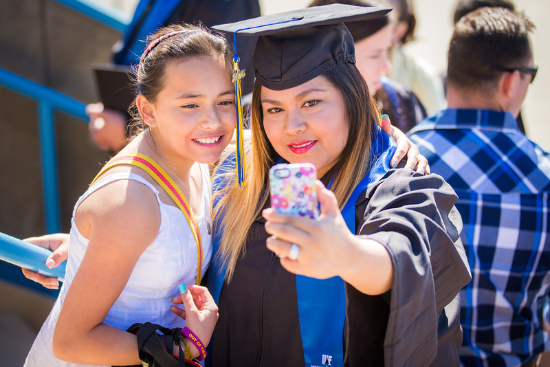 "Kaylene McCutcheon, right, and Makenzie McCutcheon takes a selfie on the steps of the Carlson Center before the UAF commencement ceremony. Kaylene McCutcheon received a medical assistant associate degree, Sunday, May 8, 2016.  <div class=""ss-paypal-button"">Filename: GRA-16-4896-122.jpg</div><div class=""ss-paypal-button-end""></div>"
