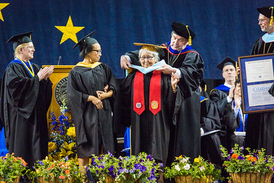 Elizabeth Kavruk Nictune Fleagle receives an honorary doctor of education degree at the commencement ceremony May 8, 2016, at the Carlson Center.  Filename: GRA-16-4896-518.jpg