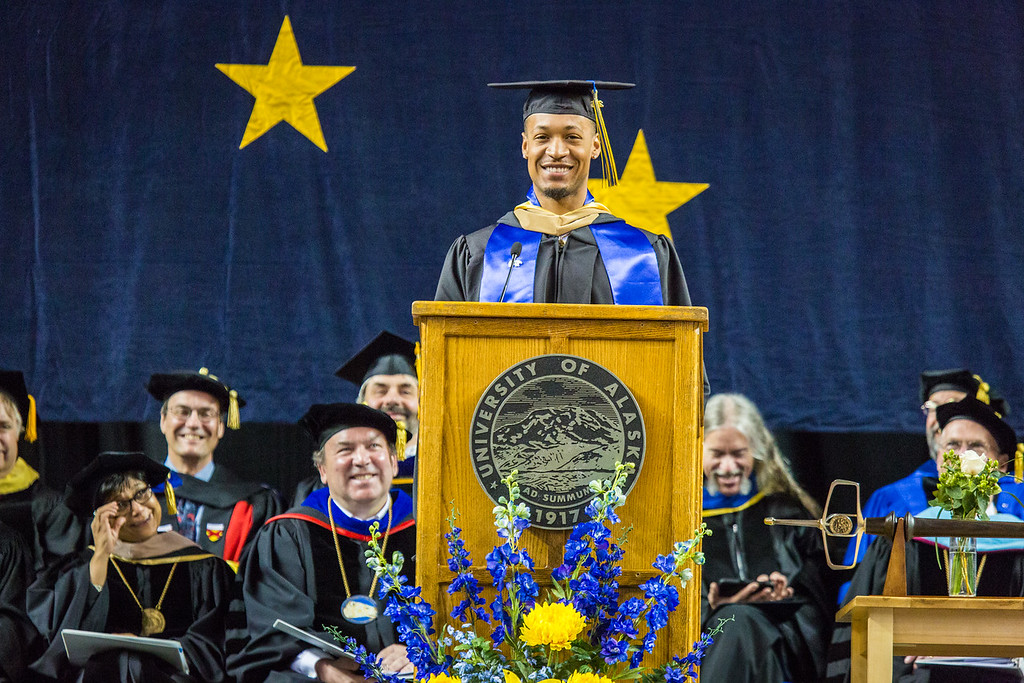 """Class speaker Joseph Slocum speaks of his time at UAF during the commencement ceremony May 8, 2016, at the Carlson Center. Slocum received an undergraduate degree in communication in 2015 and a Master of Business Administration degree in 2016.  <div class=""""ss-paypal-button"""">Filename: GRA-16-4896-1166.jpg</div><div class=""""ss-paypal-button-end""""></div>"""