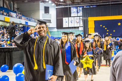 Elijah Graham is all smiles during the recessional of the Commencement 2016 ceremony inside the Carlson Center.  Filename: GRA-16-4896-1079.jpg
