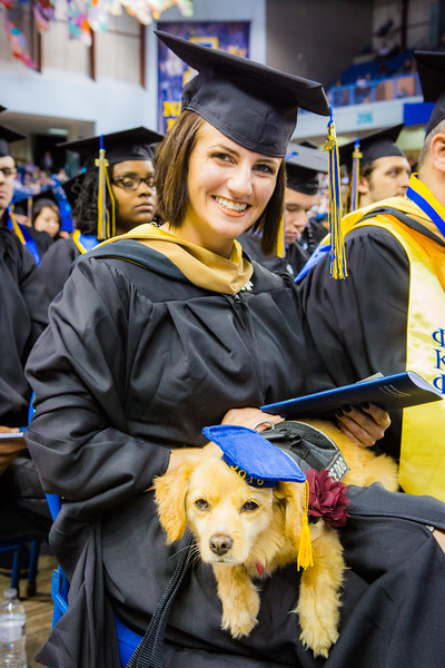 """Complete with cap and tassel, Dixie accompanied Cassandra Glebavicius, a Master in Business Administration: General Management graduate during the commencement  ceremony at the Carlson Center, Sunday, May 8, 2016.  <div class=""""ss-paypal-button"""">Filename: GRA-16-4896-222.jpg</div><div class=""""ss-paypal-button-end""""></div>"""