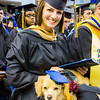 "Complete with cap and tassel, Dixie accompanied Cassandra Glebavicius, a Master in Business Administration: General Management graduate during the commencement  ceremony at the Carlson Center, Sunday, May 8, 2016.  <div class=""ss-paypal-button"">Filename: GRA-16-4896-222.jpg</div><div class=""ss-paypal-button-end""></div>"
