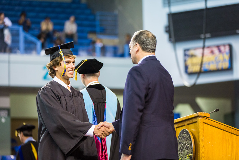 """Adam McComb received a bachelor of science degree in geoscience degree during the 2016 commencement ceremony at the Carlson Center.  <div class=""""ss-paypal-button"""">Filename: GRA-16-4896-980.jpg</div><div class=""""ss-paypal-button-end""""></div>"""