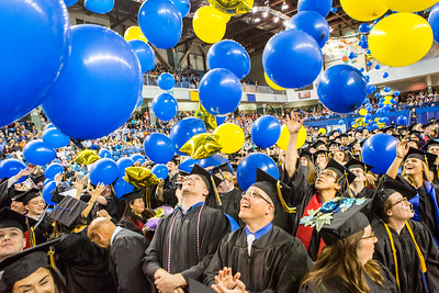 Graduates react to the ceremonial balloon drop during the Commencement 2016 ceremony.  Filename: GRA-16-4896-989.jpg