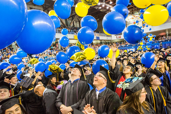 """Graduates react to the ceremonial balloon drop during the Commencement 2016 ceremony.  <div class=""""ss-paypal-button"""">Filename: GRA-16-4896-989.jpg</div><div class=""""ss-paypal-button-end""""></div>"""