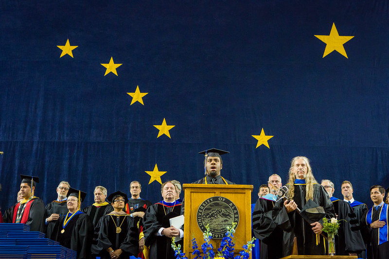 """Elijah Graham sings the national anthem at the 2016 commencement ceremony at the Carlson Center.  <div class=""""ss-paypal-button"""">Filename: GRA-16-4896-211.jpg</div><div class=""""ss-paypal-button-end""""></div>"""
