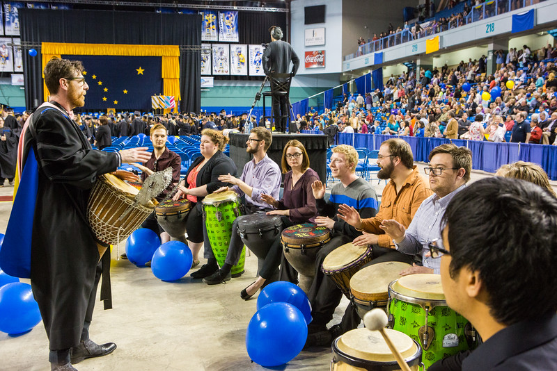 """The UAF Percussion Group, Ensemble 64.8, leads the recessional music at the Commencement 2016 ceremony inside the Carlson Center.  <div class=""""ss-paypal-button"""">Filename: GRA-16-4896-1076.jpg</div><div class=""""ss-paypal-button-end""""></div>"""