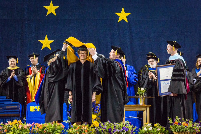 """Jacqueline A. Richter-Menge receives an honorary doctor of science degree at the commencement ceremony May 8, 2016, at the Carlson Center.  <div class=""""ss-paypal-button"""">Filename: GRA-16-4896-560.jpg</div><div class=""""ss-paypal-button-end""""></div>"""