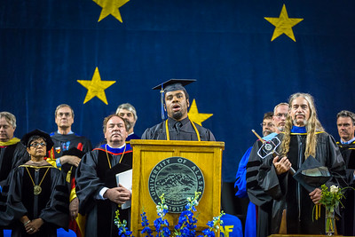 Elijah Graham sings the national anthem at the 2016 commencement ceremony at the Carlson Center.  Filename: GRA-16-4896-414.jpg