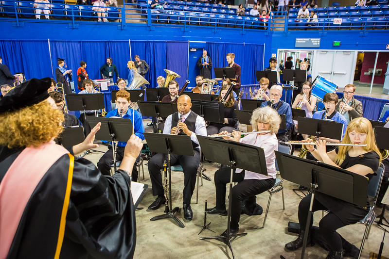 """The Wind Symphony under the direction of Karen Gustafson performs for the audience before the start of the 2016 commencement ceremony at the Carlson Center.  <div class=""""ss-paypal-button"""">Filename: GRA-16-4896-88.jpg</div><div class=""""ss-paypal-button-end""""></div>"""