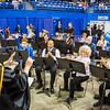 "The Wind Symphony under the direction of Karen Gustafson performs for the audience before the start of the 2016 commencement ceremony at the Carlson Center.  <div class=""ss-paypal-button"">Filename: GRA-16-4896-88.jpg</div><div class=""ss-paypal-button-end""></div>"