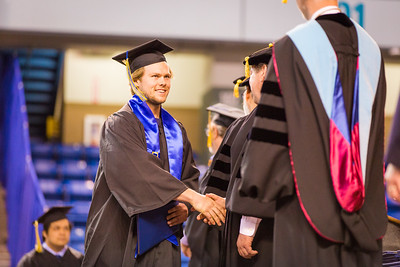 Hockey player JD Peterson is congratulated during the commencement ceremony, Sunday, May 8, 2016 at the Carlson Center. Peterson received a Bachelor of Arts degree in communication.  Filename: GRA-16-4896-963.jpg
