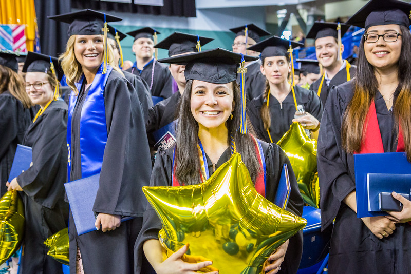 """Honors thesis scholar and magna cum laude graduate Meryem Kugzruk pauses for a phtograph during the commencement ceremony May 8, 2016, at the Carlson Center. Kugzruk received an undergraduate degree in English.  <div class=""""ss-paypal-button"""">Filename: GRA-16-4896-1030.jpg</div><div class=""""ss-paypal-button-end""""></div>"""