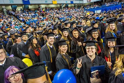 Graduates from the College of Liberal Arts pose for a portrait during commencement Sunday, May 8, 2016, at the Carlson Center.  Filename: GRA-16-4896-1036.jpg