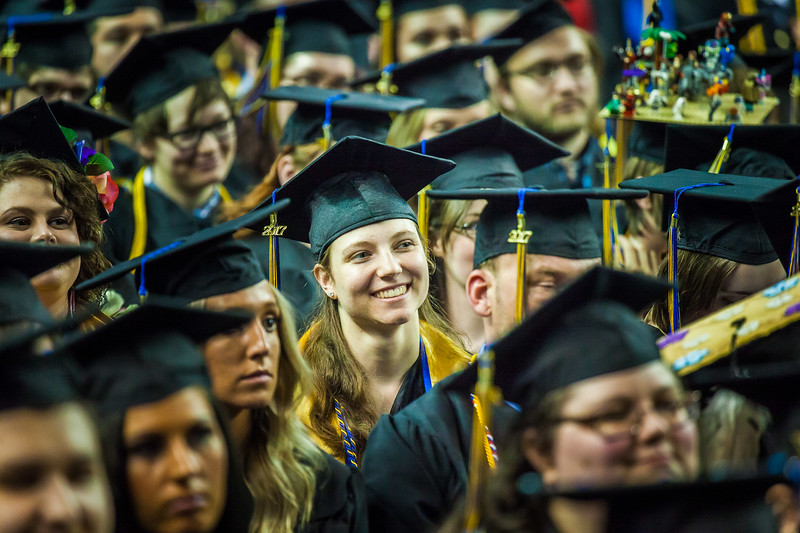 Megan Lasselle listens to class speaker Daniel Nero during the 2017 commencement ceremony at the Carlson Center, May 6.