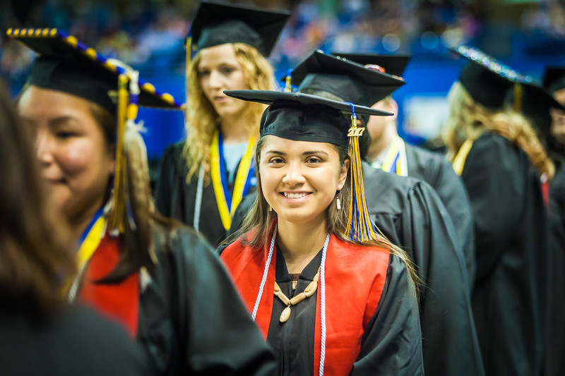 Chelsey Zibell is all smiles as she stands in line before walking across the main stage at the 2017 commencement ceremony at the Carlson Center.