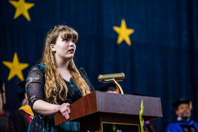 UAF performance major Casey Winkleman sings the Alaska Flag Song following the presentation of degrees and the student speaker at Commencement 2017.