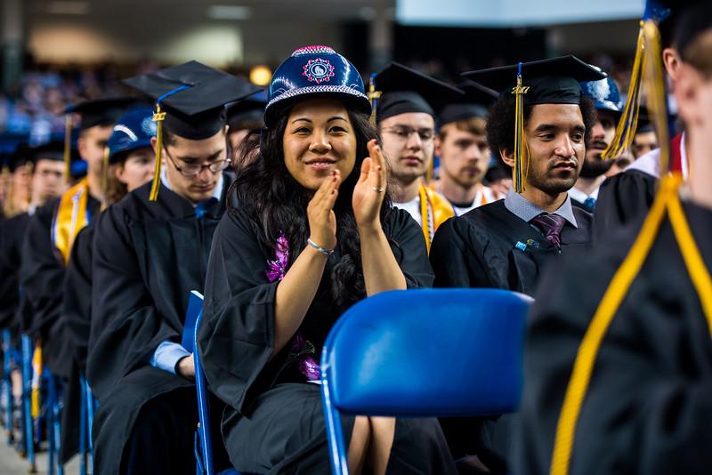 Civil engineering student Jenah Laurio applauds UA Board of Regent member Karen Purdue following her speech at Commencement 2017.