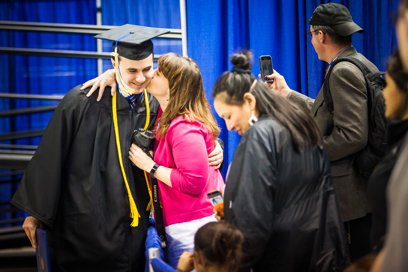 Kelly Goeden congratulates her son, Zach, after walking across the stage during the 2017 commencement ceremony at the Carlson Center.