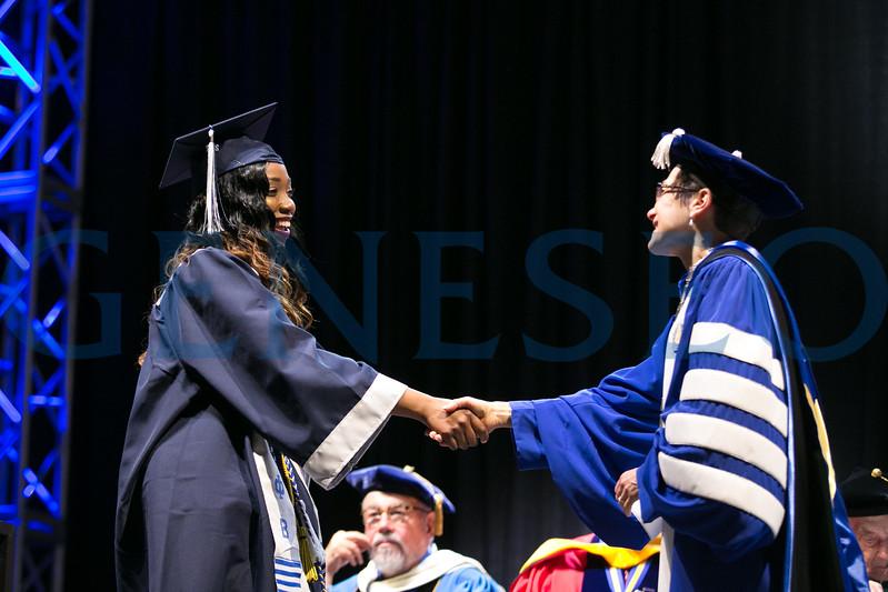 President Denise Battles greets graduate