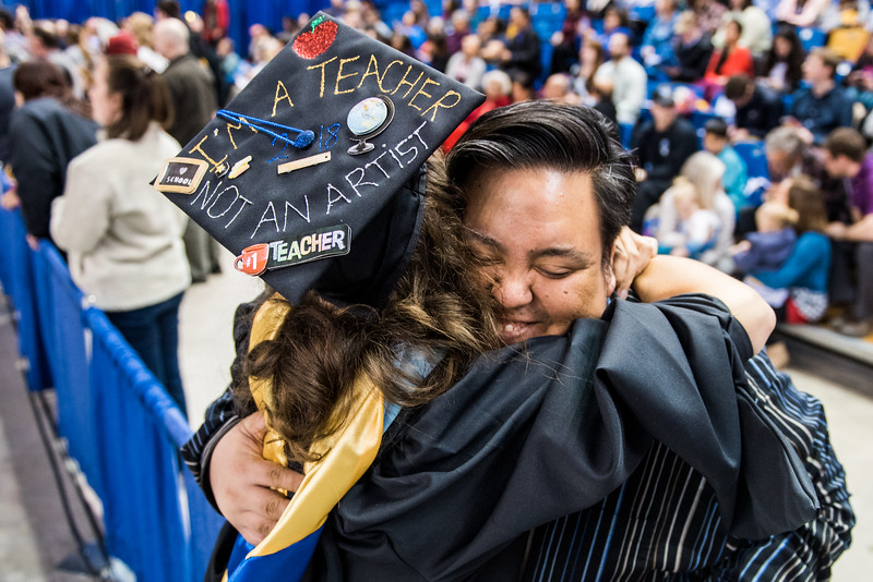 Myriam Céline Imhoff, left, hugs academic advisor Donald Crocker after receiving her master's degree in elementary education at UAF's commencement ceremony in the Carlson Center on May 5, 2018.