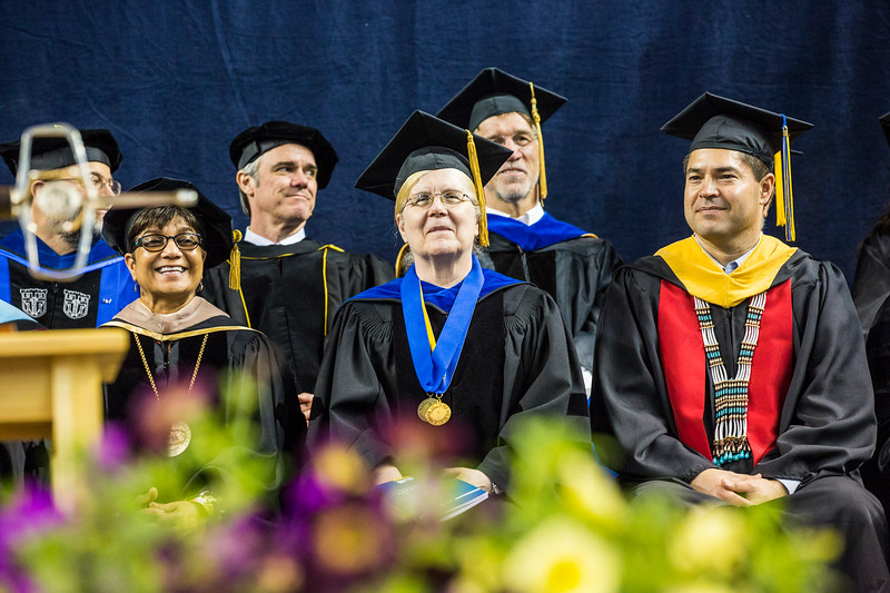 Provost Emeritus Susan Henrichs, center, smiles during UAF's commencement ceremony on May 5, 2018, in the Carlson Center.
