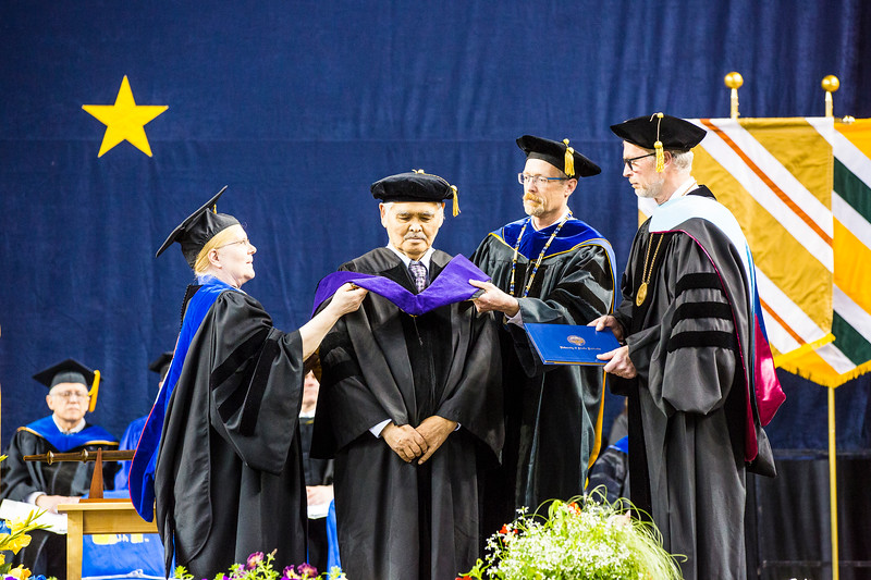 Jacob Anaġi Adams Sr. receives an honorary Doctor of Laws degree during UAF's commencement ceremony at the Carlson Center on May 5, 2018. Adams, a whaling boat captain and civic leader, was CEO of the Arctic Slope Regional Corp. from 1983-2006
