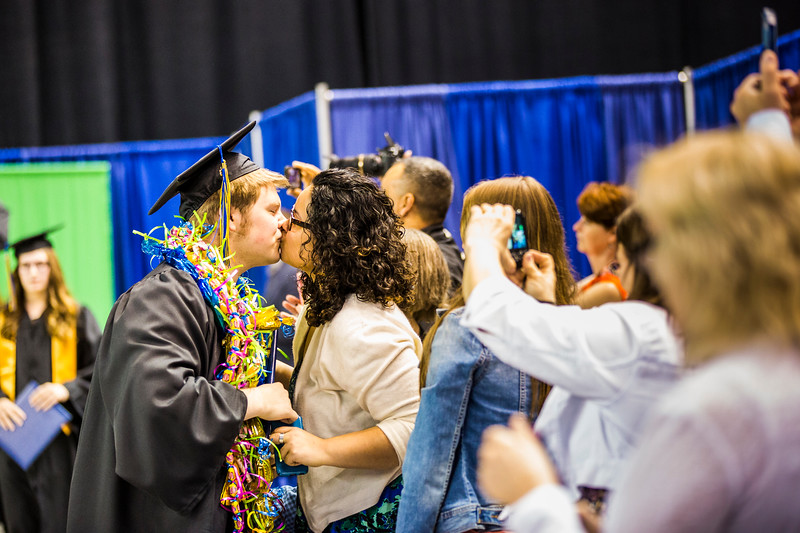 Sheridan Laapui congratulates Kelsy Nore, who earned a bachelor's degree in film and performing arts, during UAF's commencement ceremony at the Carlson Center on May 5, 2018.