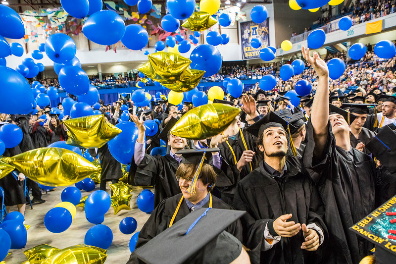 Graduates react to the ceremonial balloon drop during UAF's commencement ceremony in the Carlson Center on May 5, 2018.