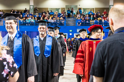 UAF faculty members proceed to their seats during the 2018 commencement ceremony at the Carlson Center on May 5, 2018.