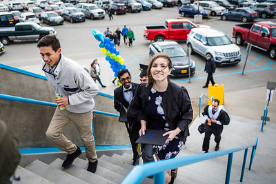 Kennedy Demboski, who graduated with a bachelor's degree in biological sciences, enters the Carlson Center before UAF's commencement ceremony Saturday, May 5, 2018.