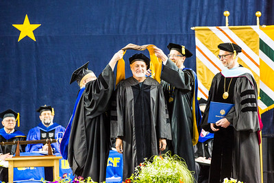 "Musician and songwriter James Milton Varsos, also known as ""Hobo Jim,"" receives an honorary Doctor of Fine Arts degree during UAF's commencement ceremony at the Carlson Center on May 5, 2018."