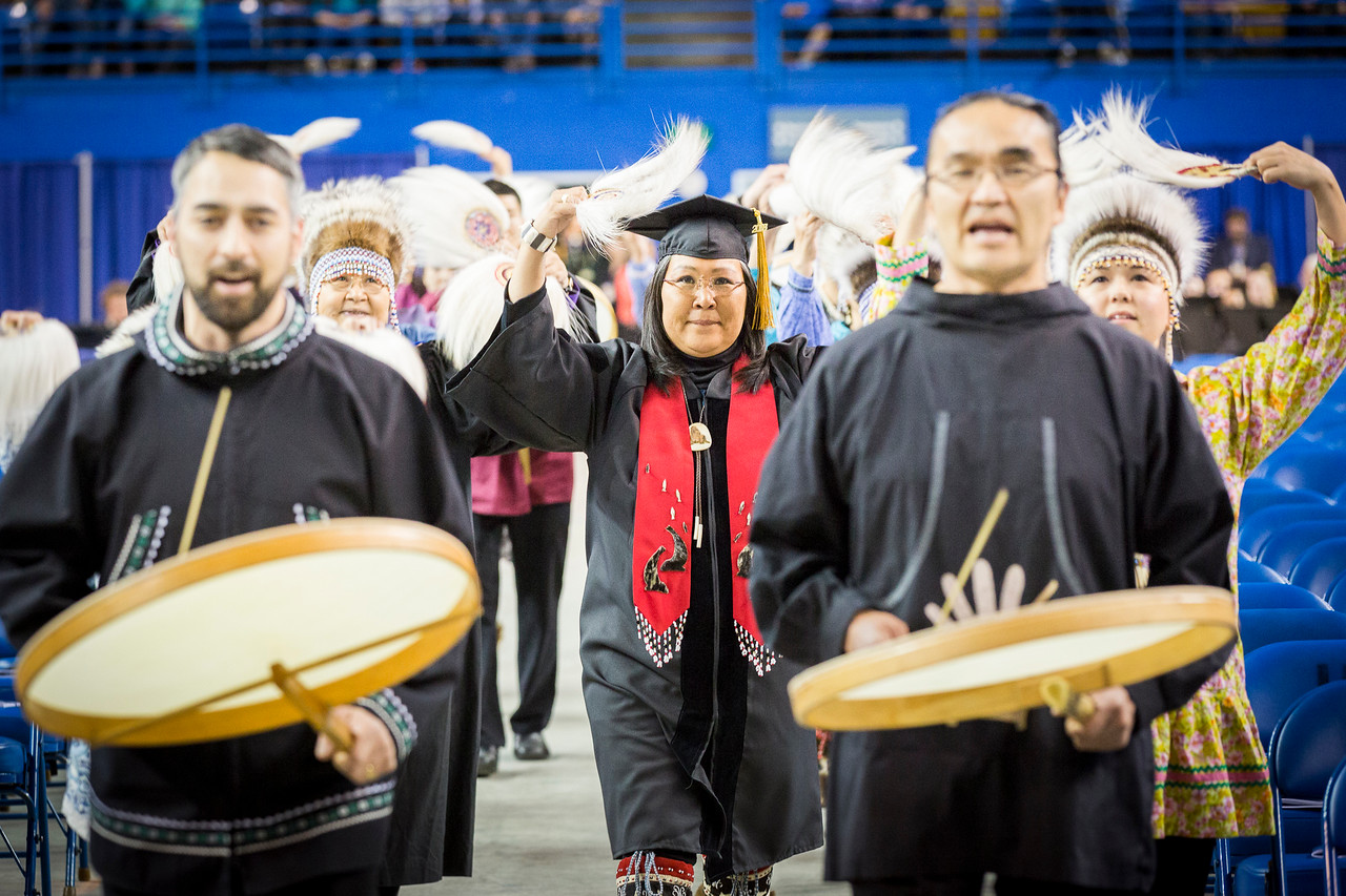 Agatha John-Shields, a doctoral student in applied linguistics, performs with the Acilquq dance group to start UAF's commencement ceremony at the Carlson Center on May 5, 2018.