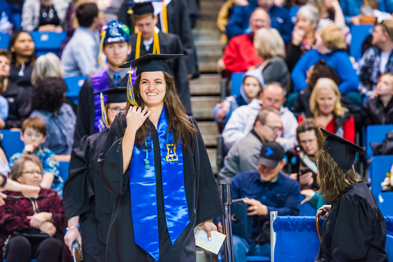Tatjana Spaic, who earned a bachelor's degree in geological engineering, walks onto the floor as UAF's commencement ceremony begins in the Carlson Center on May 5, 2018.