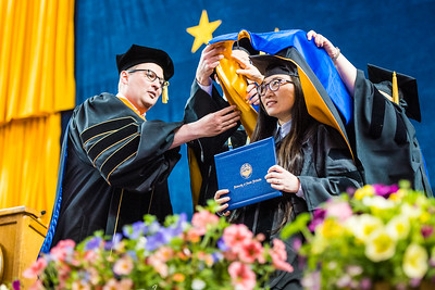 Shan Shan Li receives her doctorate in geophysics during UAF's commencement ceremony at the Carlson Center on May 5, 2018.