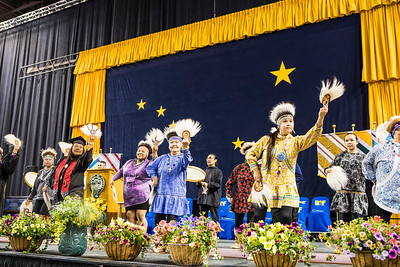 Members of the Acilquq dance group perform on stage after leading the processional at UAF's commencement ceremony on May 5, 2018.