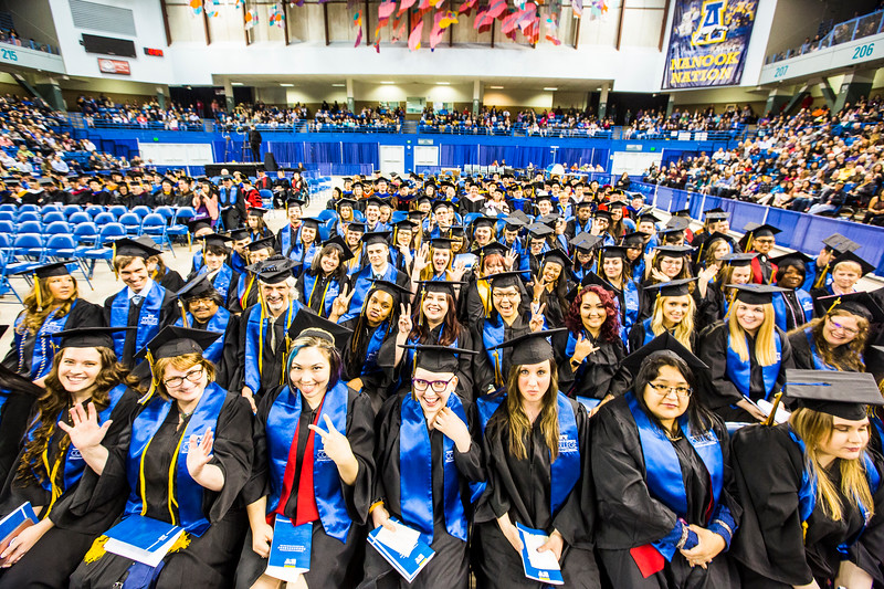 Graduates of UAF's Community and Technical College await the granting of their degrees during UAF's commencement ceremony on May 5, 2018, at the Carlson Center.