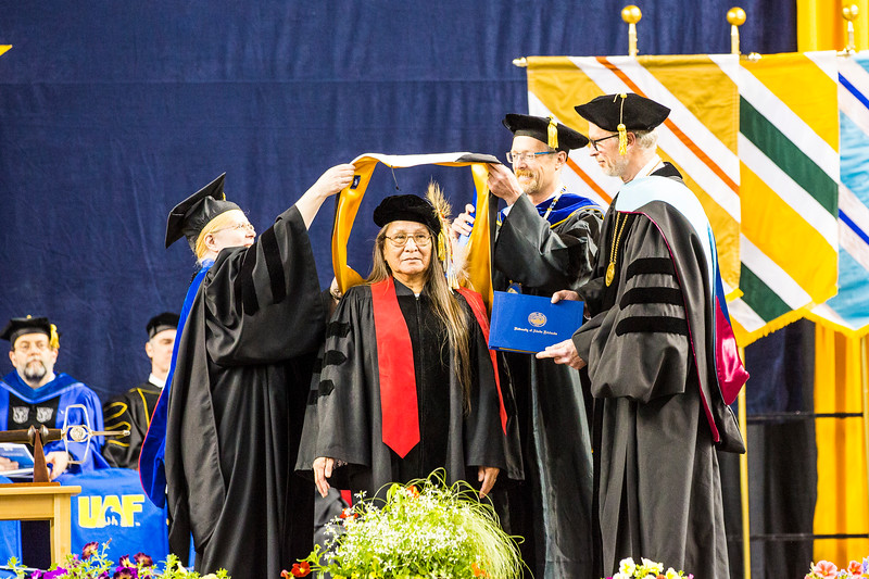Antonia Loretta Afraid of Bear-Cook, an Oglala Lakota leader, teacher and culture bearer, receives an honorary Doctor of Humanities degree during UAF's commencement ceremony at the Carlson Center on May 5, 2018.