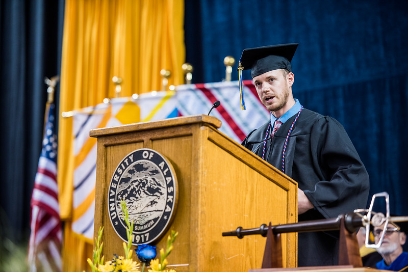 Student speaker Aaron Cottle, who earned a bachelor's degree in marketing, speaks during UAF's commencement ceremony at the Carlson Center on May 5, 2018.