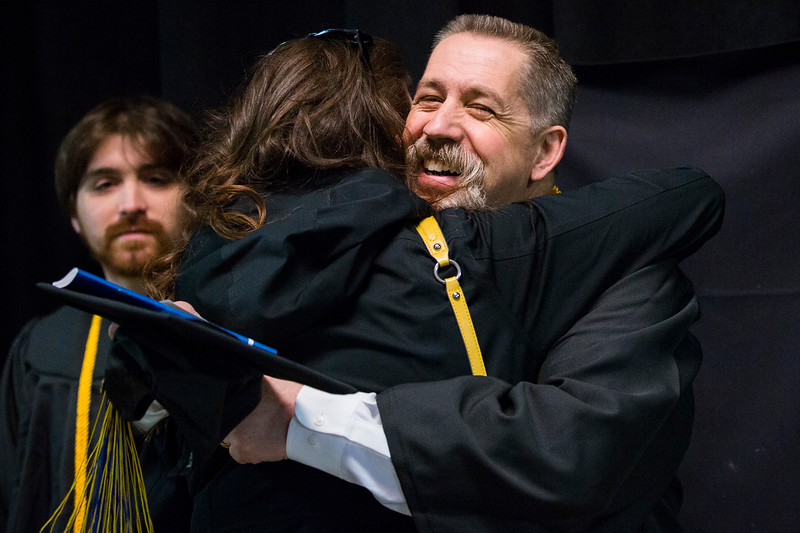 University Fire Department Captain Benjamin D. Fleagle receives an embrace from his daughter, Faith, before the UAF commencement ceremony at the Carlson Center on May 5, 2018. Capt. Fleagle received a Bachelor of Arts in history.