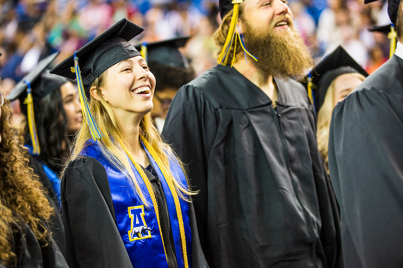 Sagen Maddalena, who earned a bachelor's degree in natural resource management, enjoys the program at UAF's commencement ceremony on May 5, 2018. Maddalena was a member of the Alaska Nanooks rifle team.