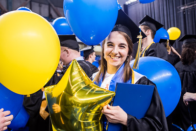 Sarissa Lammers, who earned a bachelor's degree in mechanical engineering, holds a balloon dropped from the ceiling at the end of UAF's commencement ceremony in the Carlson Center on May 5, 2018.
