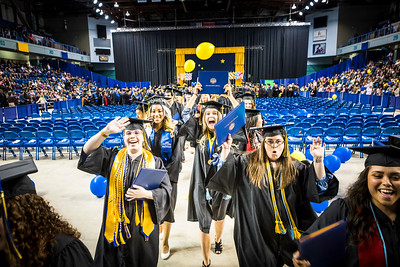 Graduates dance to the beat provided by Ensemble 64.8, a percussion group, as they leave the Carlson Center following UAF's commencement ceremony on May 5, 2018.