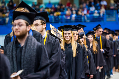 Hannah Sarah Carlile, who earned bachelor's degrees in both French and linguistics, smiles during UAF's commencement ceremony at the Carlson Center on May 5, 2018.